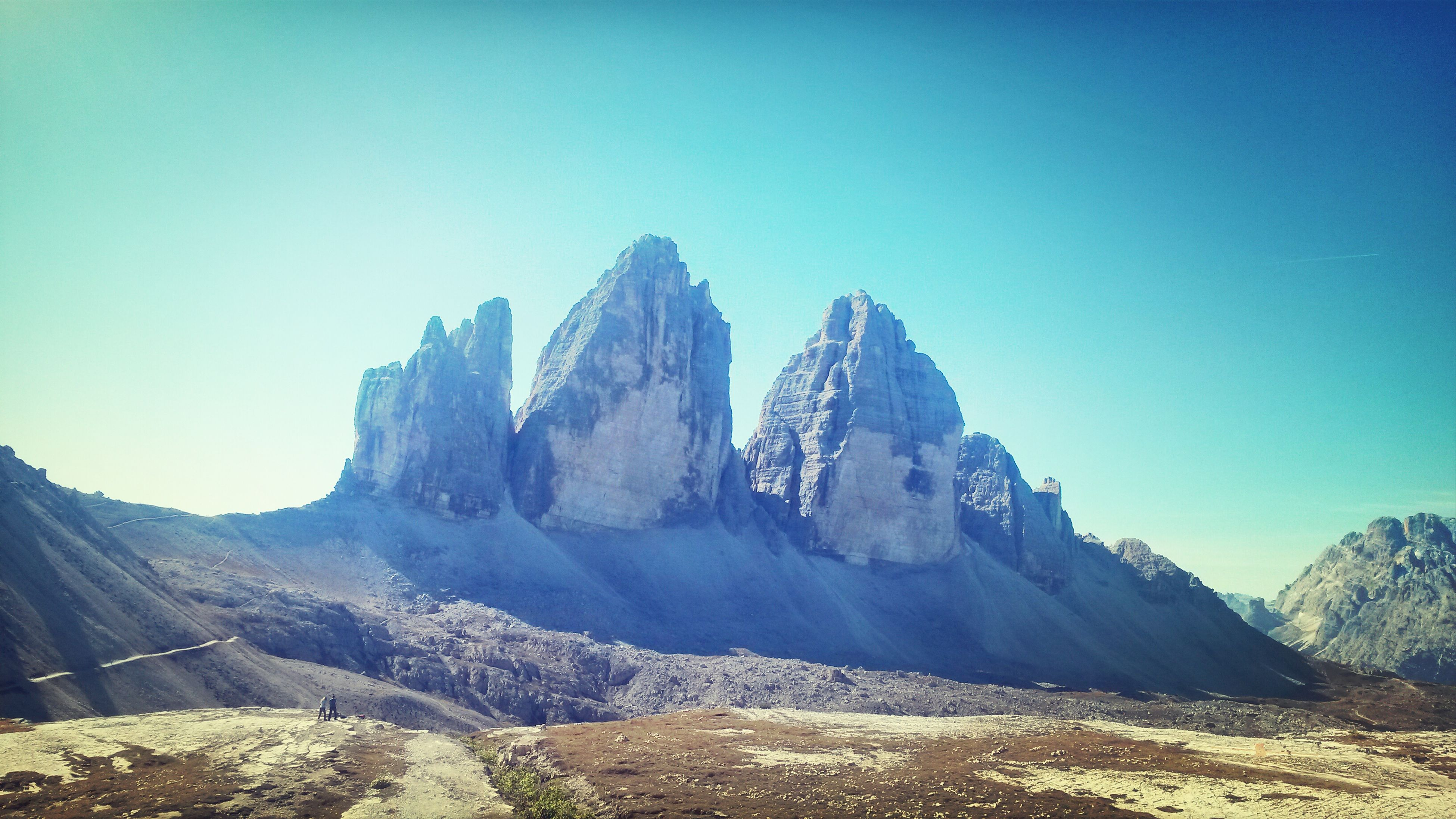 mountain, clear sky, scenics, tranquil scene, tranquility, beauty in nature, mountain range, blue, copy space, landscape, nature, snow, geology, physical geography, winter, non-urban scene, cold temperature, rocky mountains, rock - object, idyllic