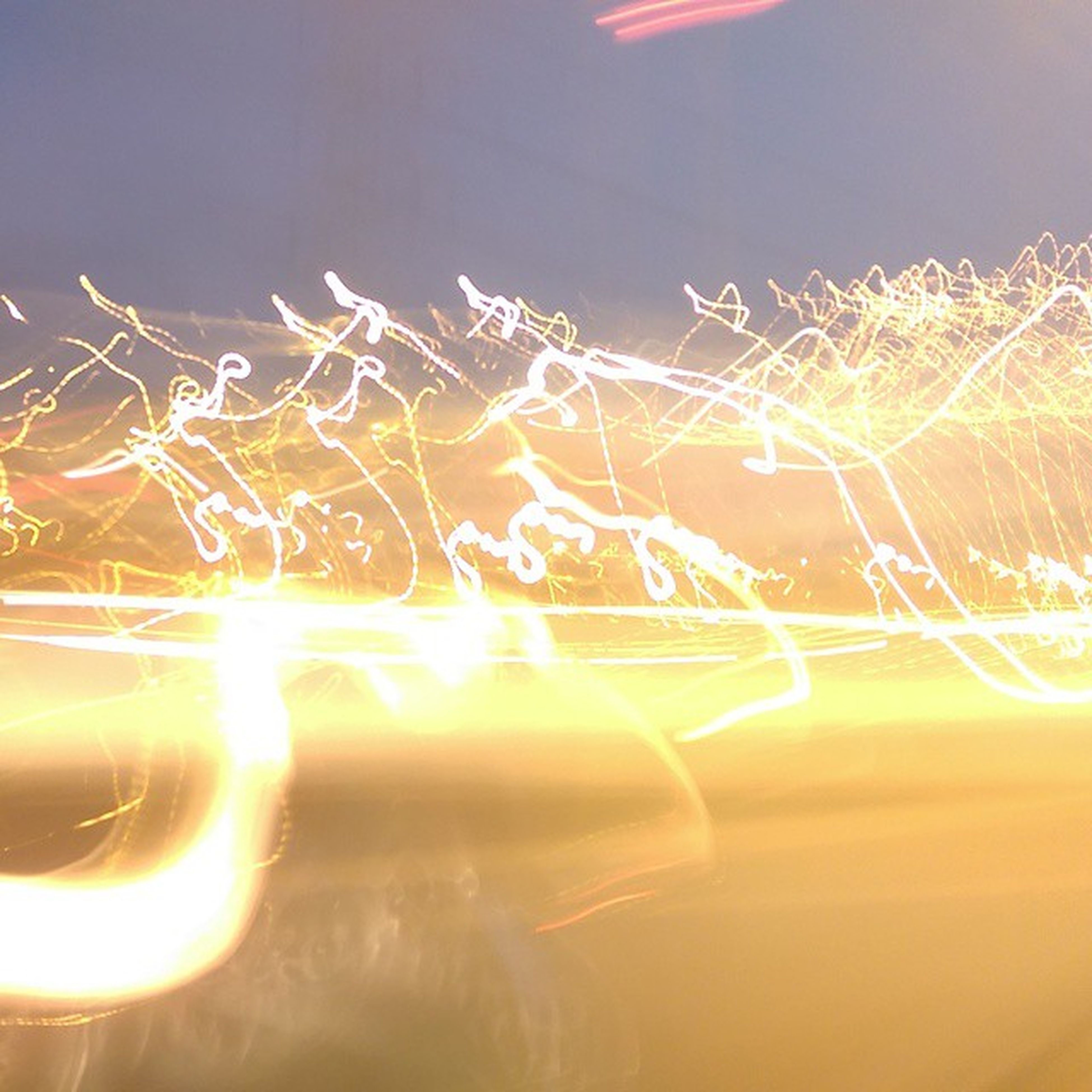 illuminated, night, glowing, long exposure, motion, multi colored, light trail, abstract, light - natural phenomenon, blurred motion, light painting, lighting equipment, no people, light, speed, close-up, lens flare, outdoors, light effect, reflection