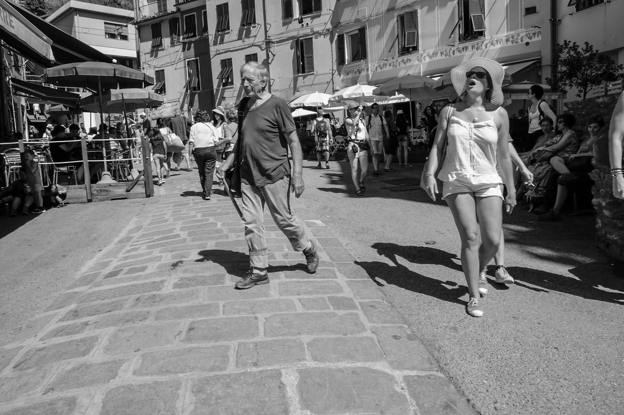 real people, full length, large group of people, lifestyles, building exterior, built structure, walking, architecture, women, outdoors, leisure activity, casual clothing, day, sunlight, men, shadow, city, adult, people, adults only