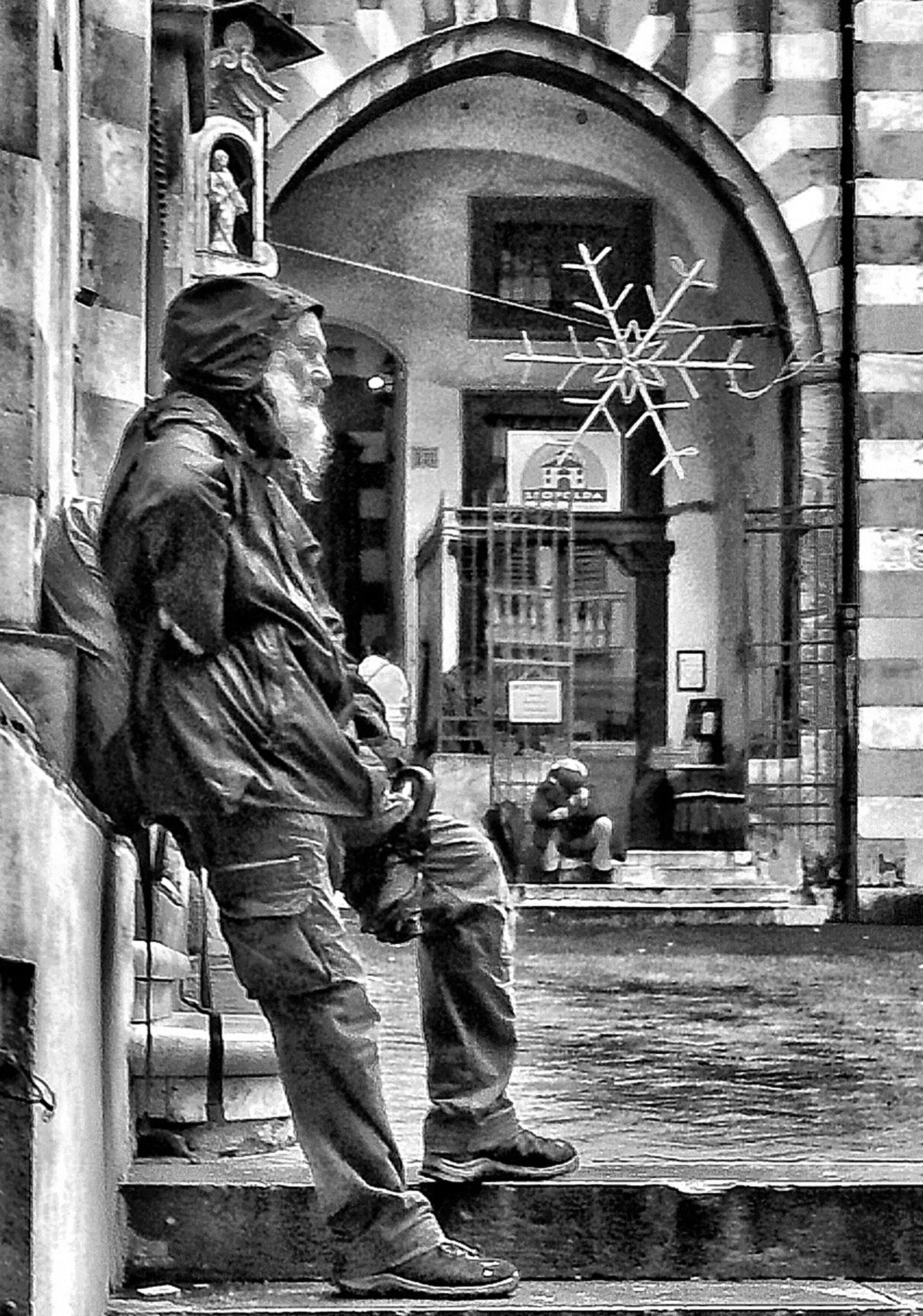 building exterior, architecture, built structure, human representation, men, city, statue, street, full length, art and craft, lifestyles, sculpture, art, creativity, rear view, standing, walking, day