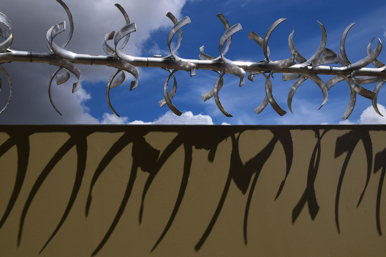 metal, protection, security, safety, outdoors, day, no people, razor wire, low angle view, close-up, sky, nature