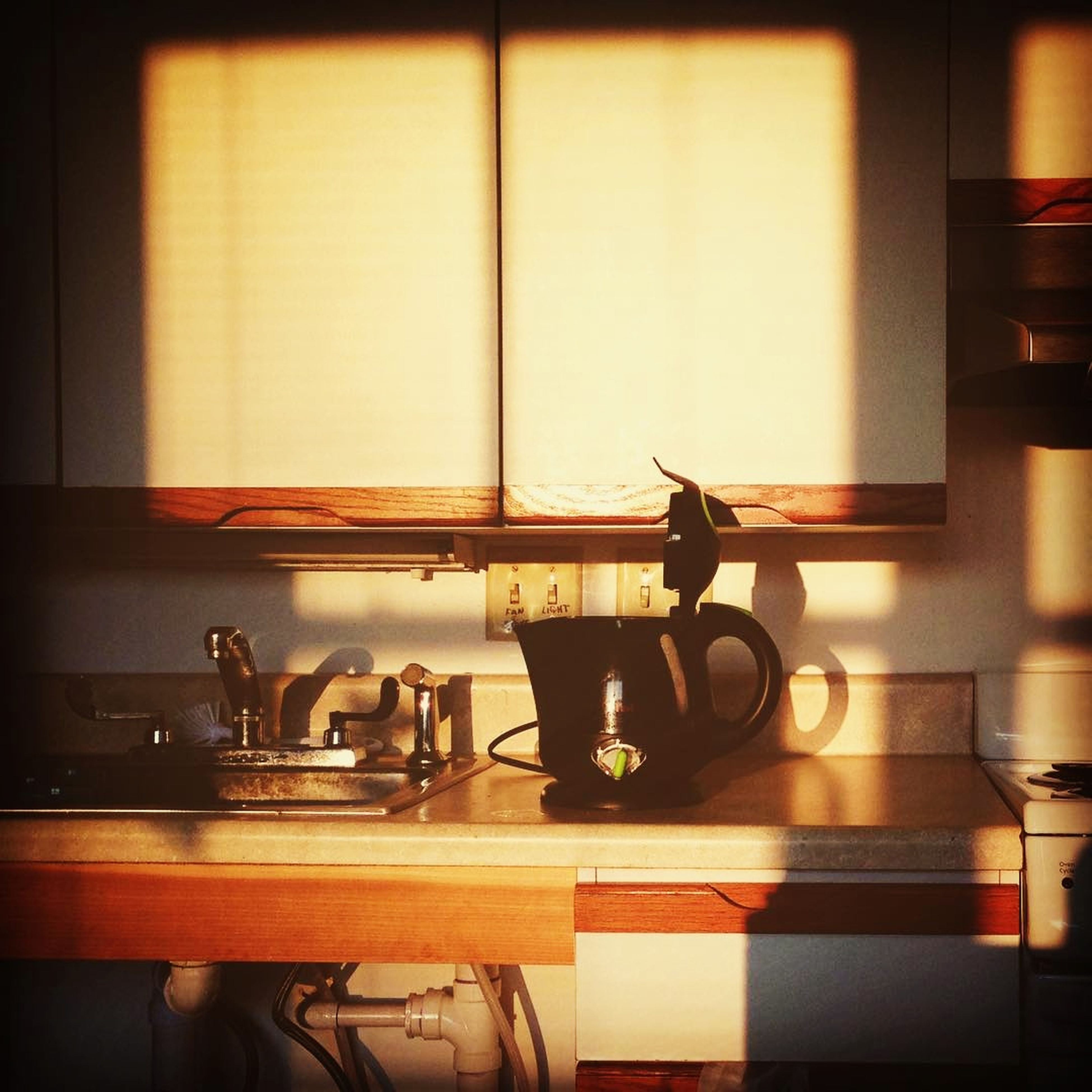 domestic kitchen, kitchen, indoors, domestic room, home interior, no people, kitchen counter, shelf, stove, neat, home showcase interior, cabinet, day