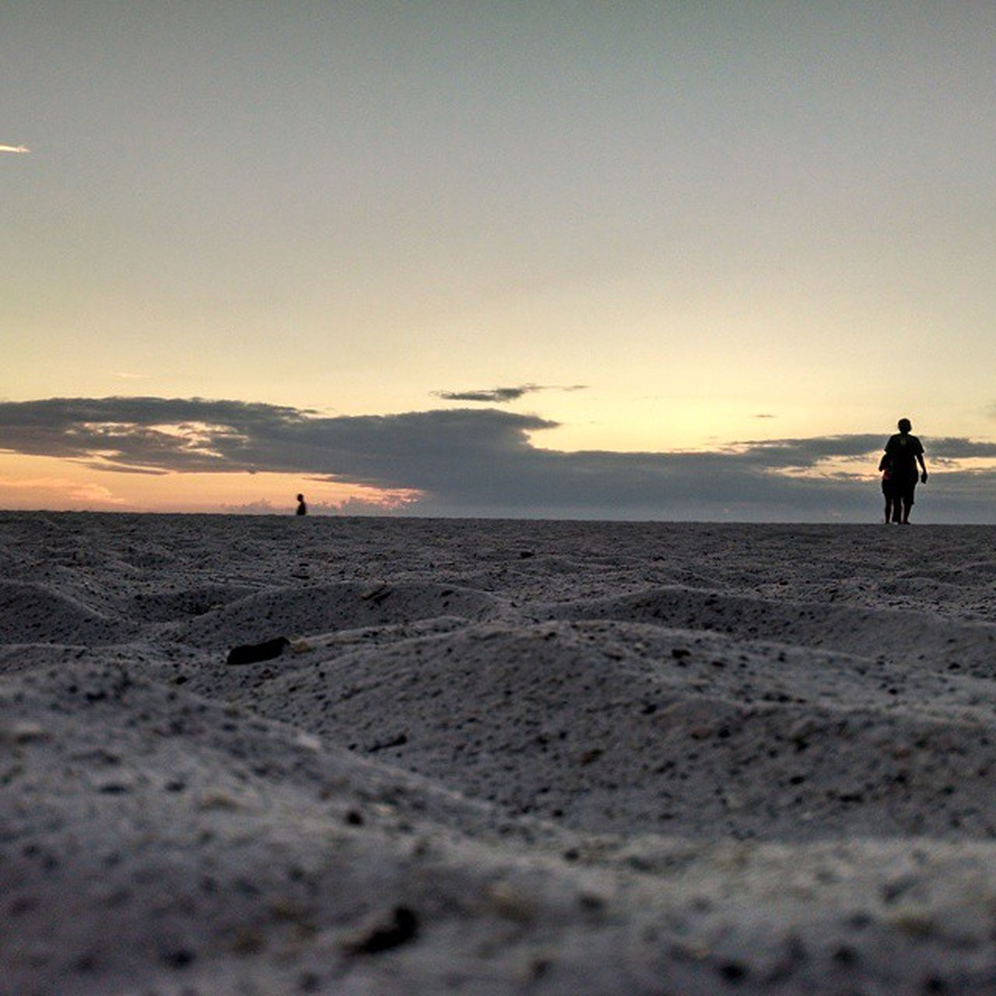 lifestyles, leisure activity, beach, men, silhouette, sunset, sky, sea, full length, walking, sand, horizon over water, tranquil scene, person, shore, vacations, standing