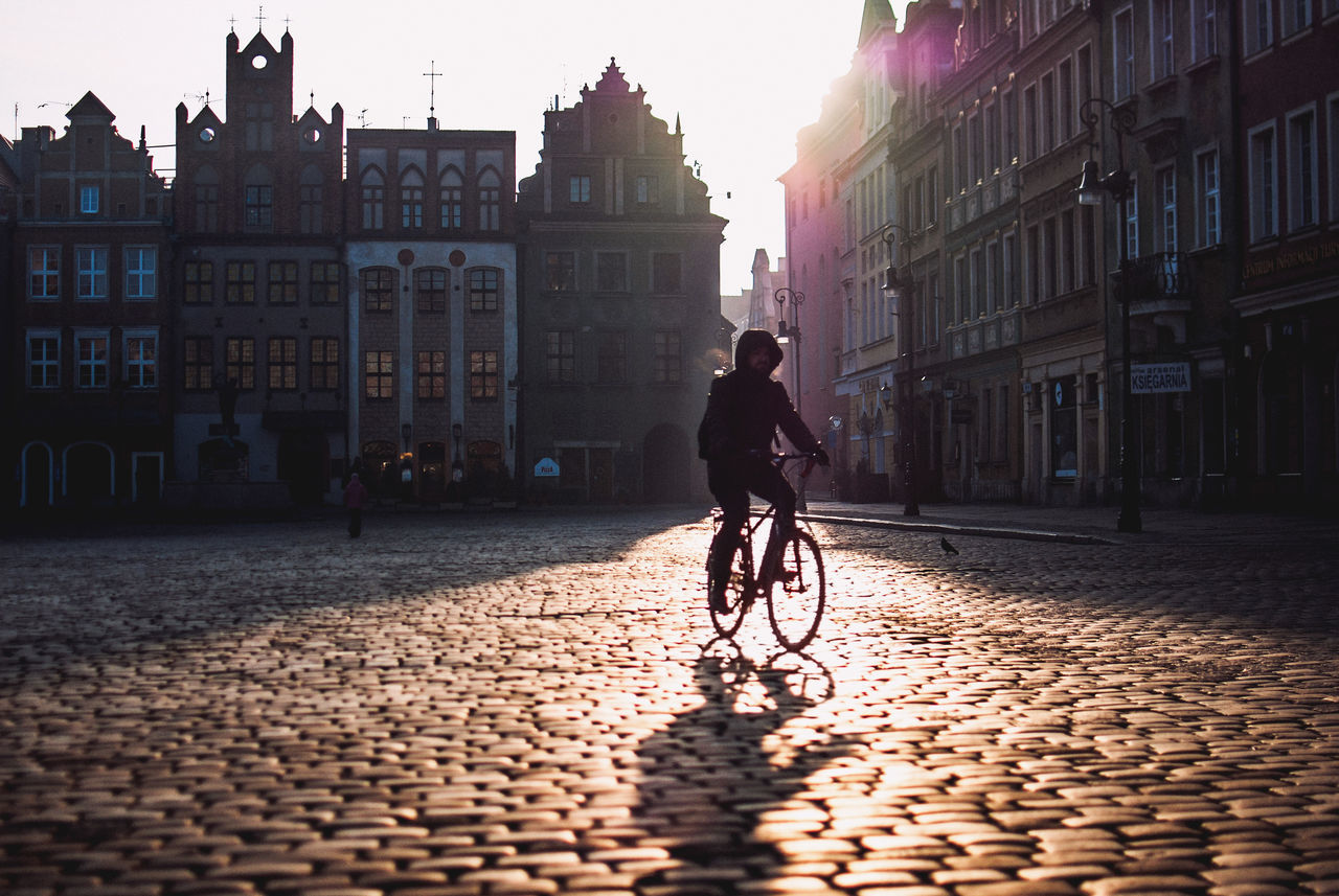 Adult Adults Only Architecture Bicycle Building Exterior Built Structure City City Cobblestone Cycling Discover Your City Europe Full Length Light And Shadow Men Nikon One Man Only One Person Outdoors People Streetphotography Sunbeam The Week Of Eyeem Travel Winter