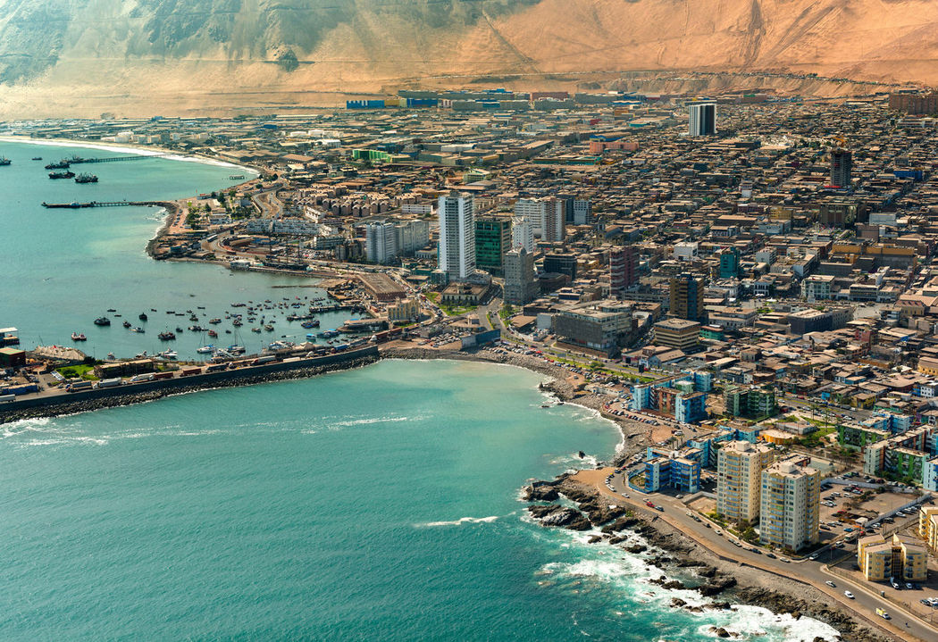 Aerial view of downtown Iquique in the Atacama Desert, Chile Atacama Desert Chile Chilean  City Coastline Downtown Iquique Region De Tarapaca Aerial Aerial View Arid Arid Climate Coast Dry Elevated View Latin American Pacific Ocean Port Shore Shoreline Tarapaca Urban Urban Skyline Water Waterfront