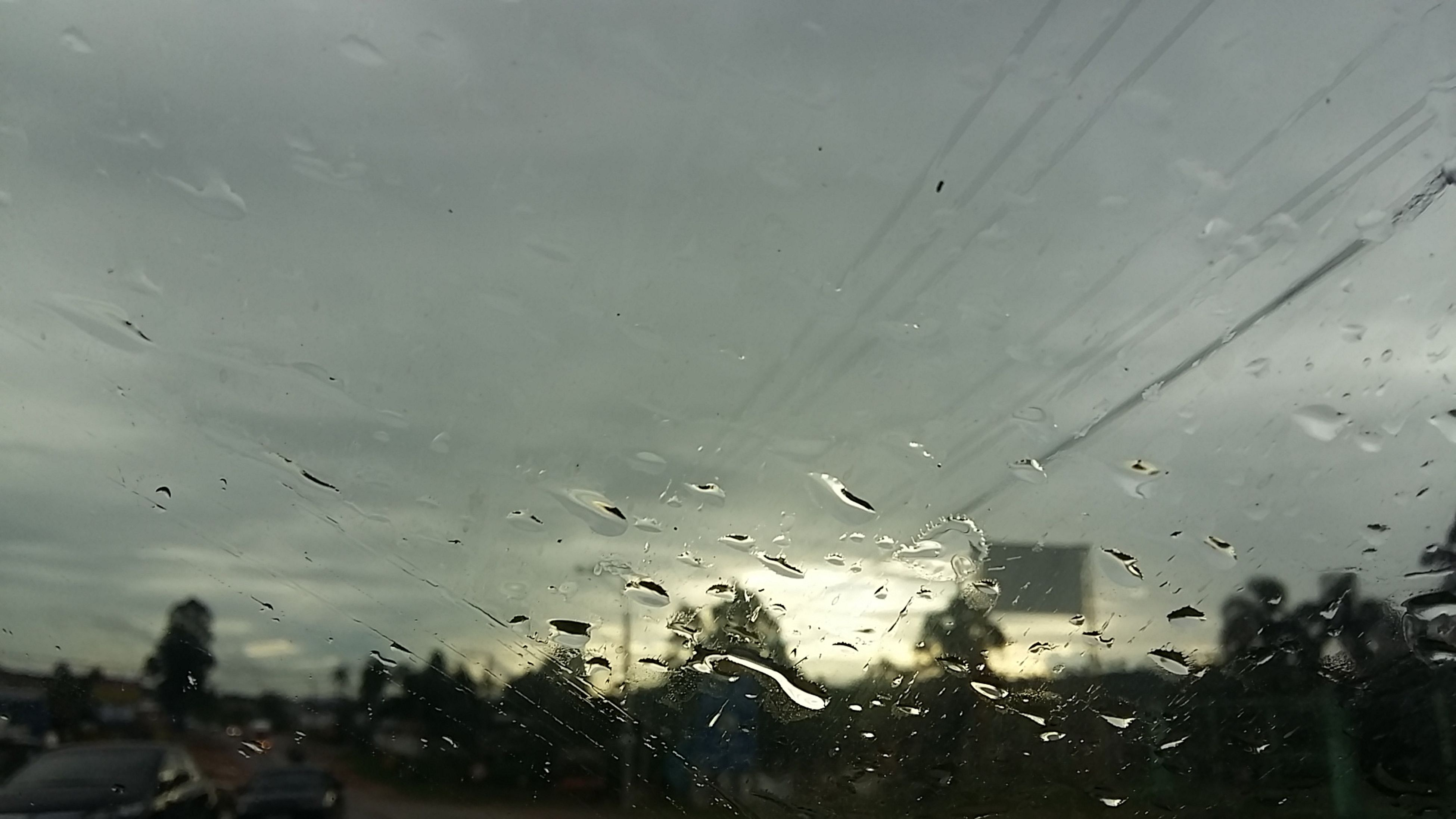 drop, wet, window, rain, transparent, glass - material, water, car, transportation, indoors, weather, raindrop, season, land vehicle, mode of transport, sky, vehicle interior, glass, monsoon, road