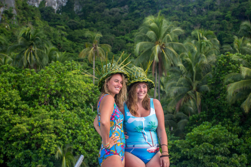 Connected By Travel Adult Adults Only Bikini Bonding Day Friendship Fun Happiness Leisure Activity Nature Only Young Women Outdoors Palm Tree People Philippines Palawan Real People Smiling Standing Togetherness Tree Two People Vacations Young Adult Young Women