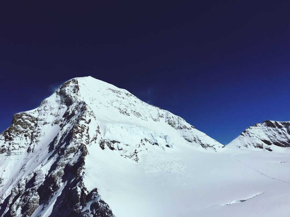 Snow Winter Cold Temperature Copy Space Mountain Snowcapped Mountain Tranquility Clear Sky Tranquil Scene Nature Scenics Beauty In Nature Mönch Jungfrauregion Switzerland Berner Oberland Berner Alpen Swiss Alps Outdoors Low Angle View No People Mountain Peak Day Sky