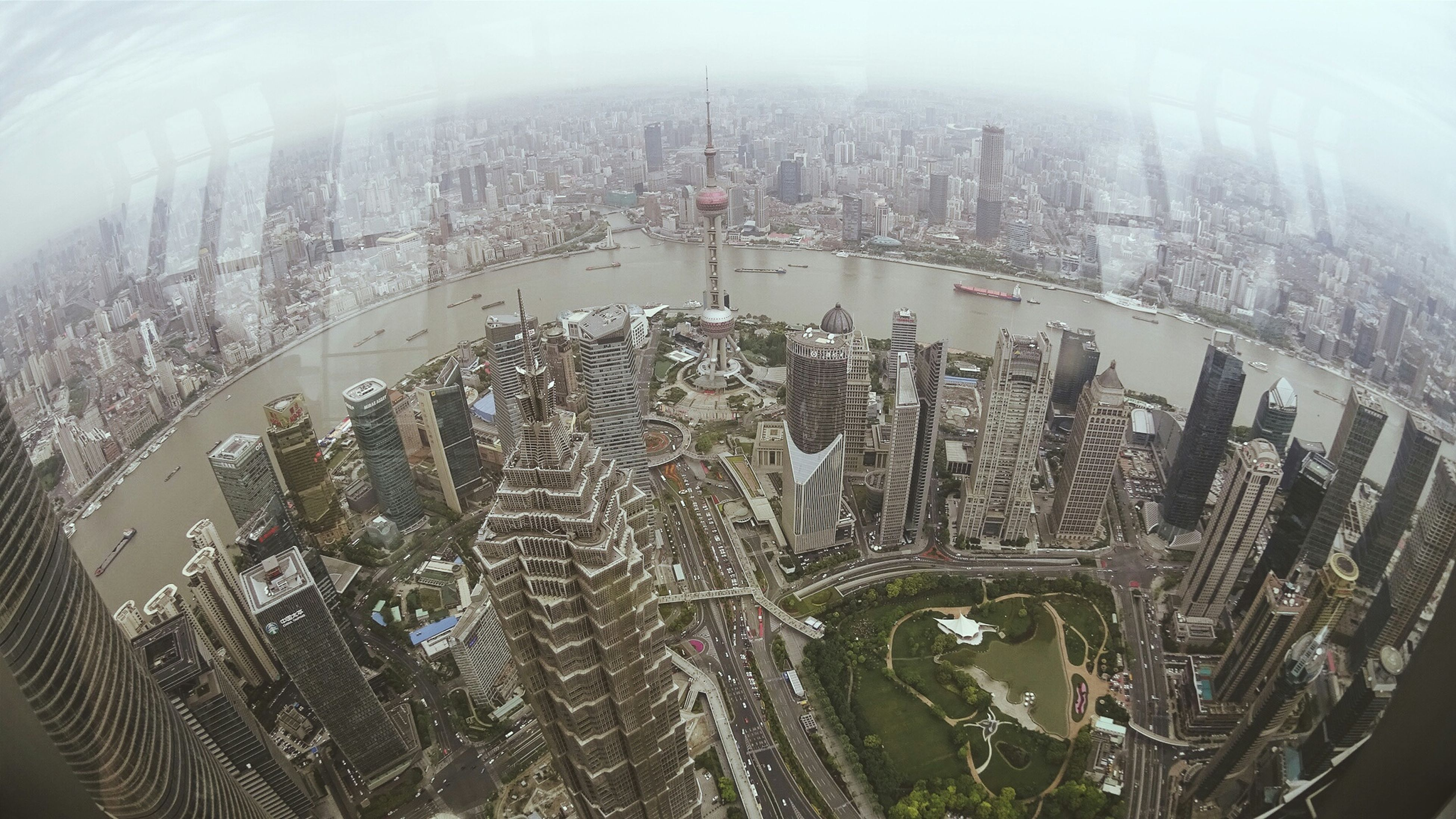architecture, built structure, city, high angle view, building exterior, cityscape, aerial view, skyscraper, capital cities, famous place, travel destinations, tall - high, travel, ferris wheel, international landmark, water, tower, tourism, modern, transportation
