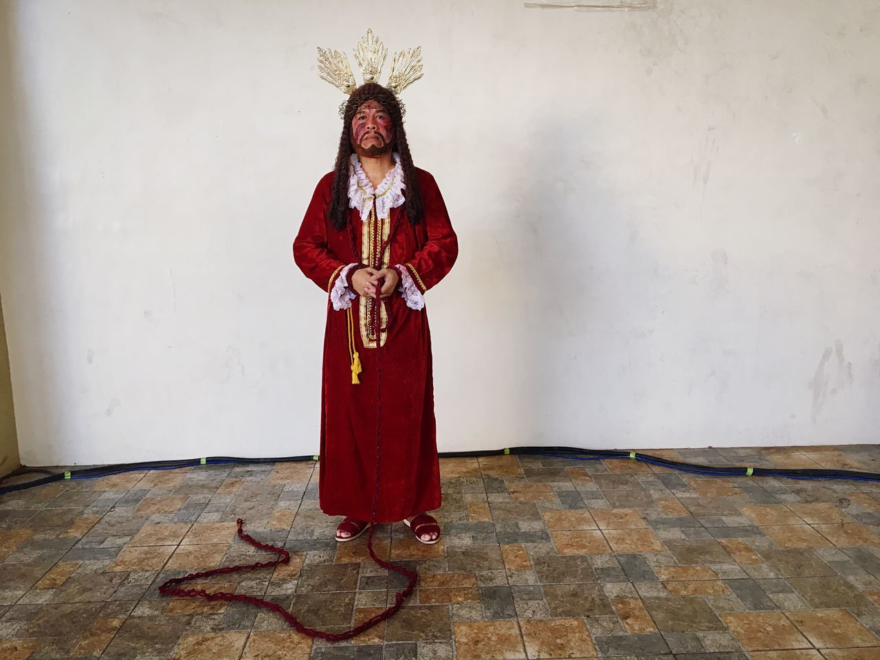 """Jun Taytay, 59, portrays Jesus Christ in an annual performance called """"cenaculo"""", a performance to commemorate the passion and death of Jesus Christ on Good Friday, in Malibay, Metro Manila. Jun is the 4th person to portray Jesus since 1902 in the neighbourhood. He has been doing this for 21 years as a personal devotion. Full Length Indoors  One Person Real People Standing Stage Costume Day People EyeEm Best Shots Pasay City Street Play Arts Culture And Entertainment Manila Good Friday Philippines Holy Week Jesus Christ The Passion Of The Christ. Religion"""