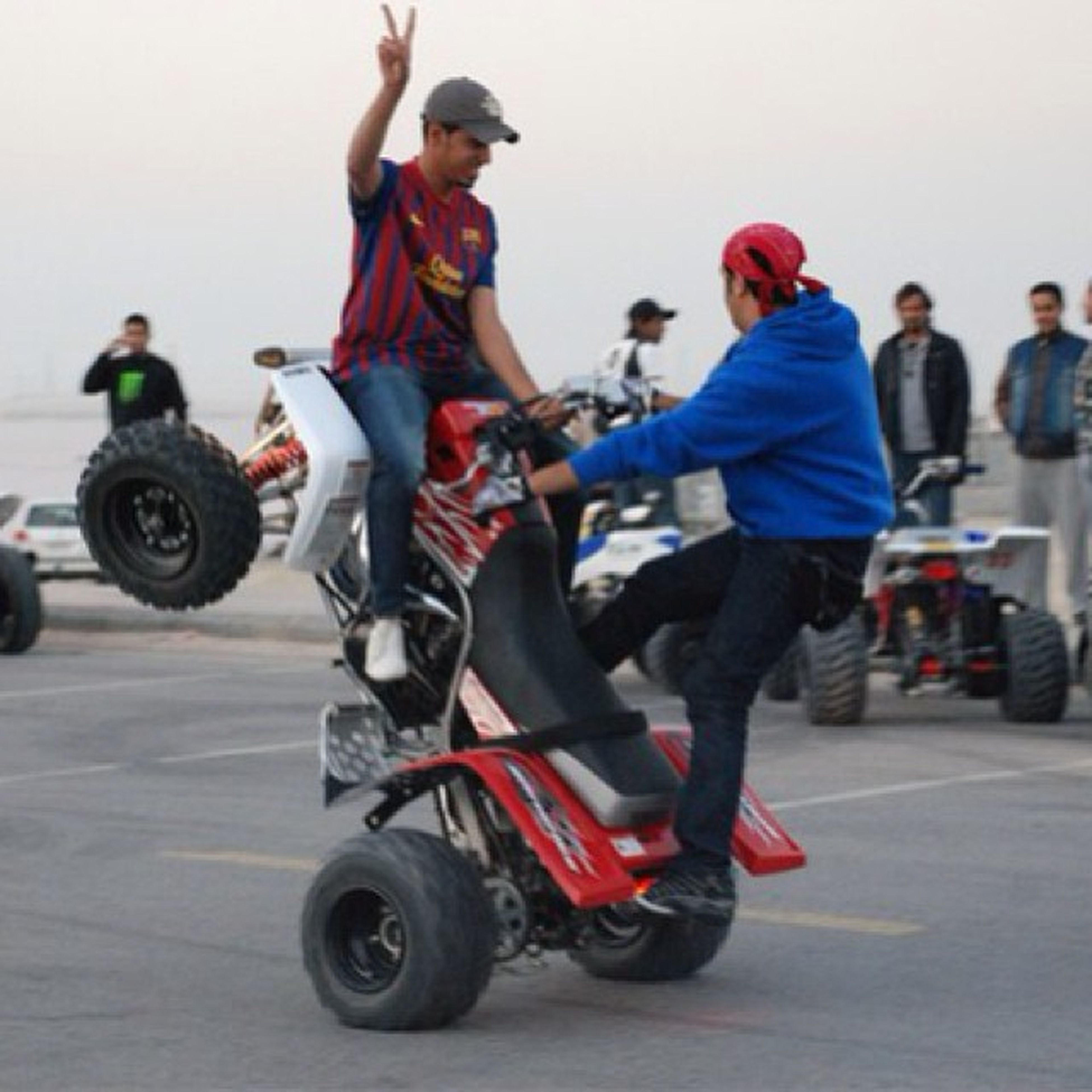 lifestyles, men, leisure activity, transportation, riding, full length, bicycle, land vehicle, skill, mode of transport, sport, motion, mid-air, person, casual clothing, large group of people, cycling, extreme sports, on the move