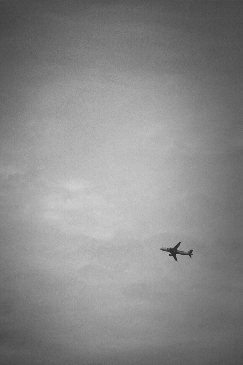airplane, flying, air vehicle, transportation, mode of transport, mid-air, sky, low angle view, cloud - sky, on the move, travel, journey, silhouette, nature, outdoors, copy space, day, beauty in nature, no people, scenics