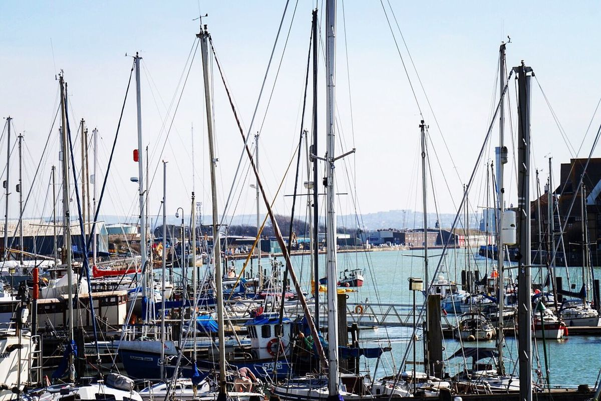 Masts Mast Moored Transportation Nautical Vessel Mode Of Transport Harbor Water Sailboat Sky Outdoors Day Sea No People Stationary Building Exterior Nature Architecture Sailing Ship