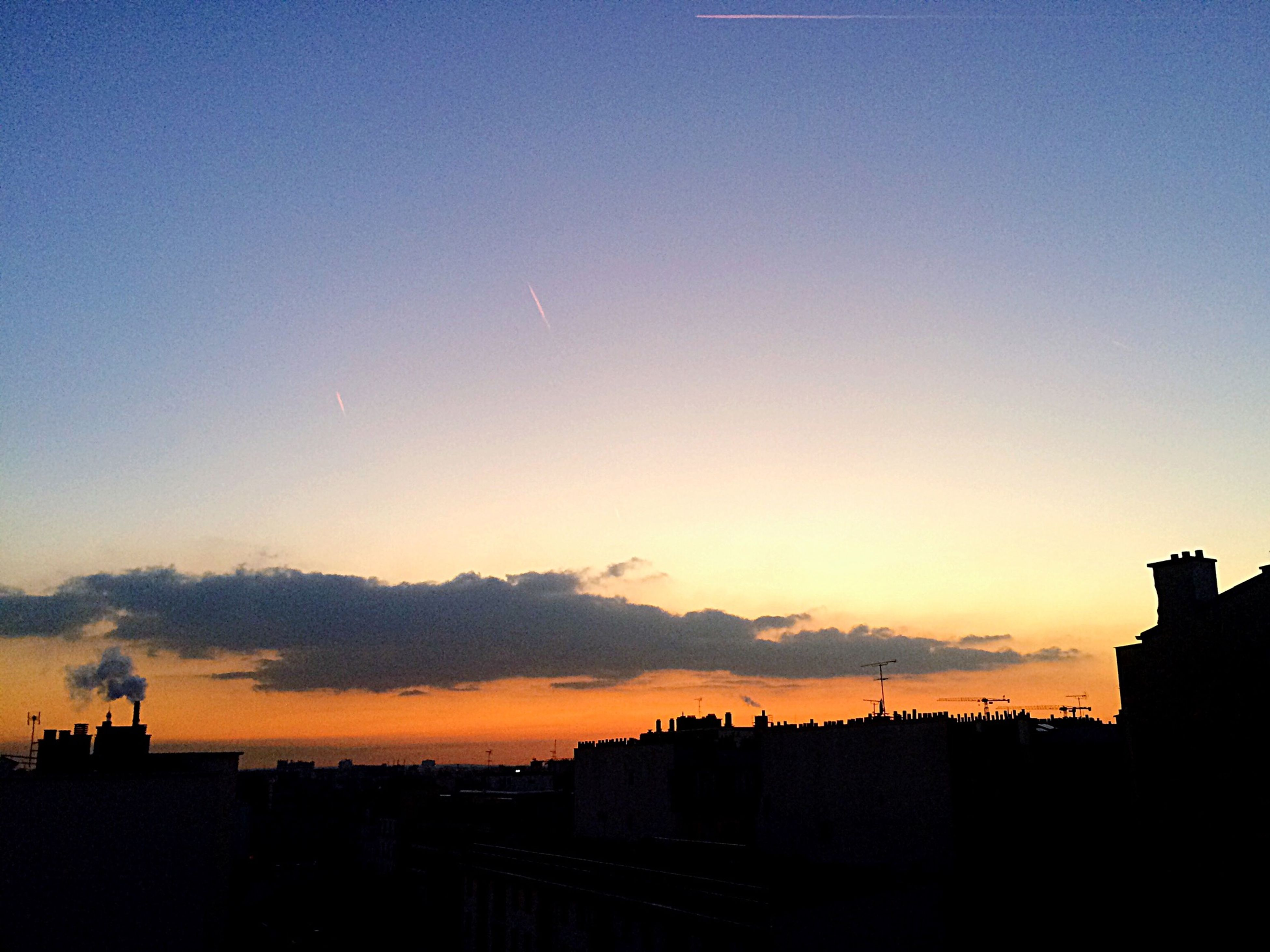 sunset, building exterior, silhouette, architecture, built structure, city, copy space, sky, orange color, cityscape, residential structure, residential building, blue, dusk, building, scenics, house, beauty in nature, outdoors, nature