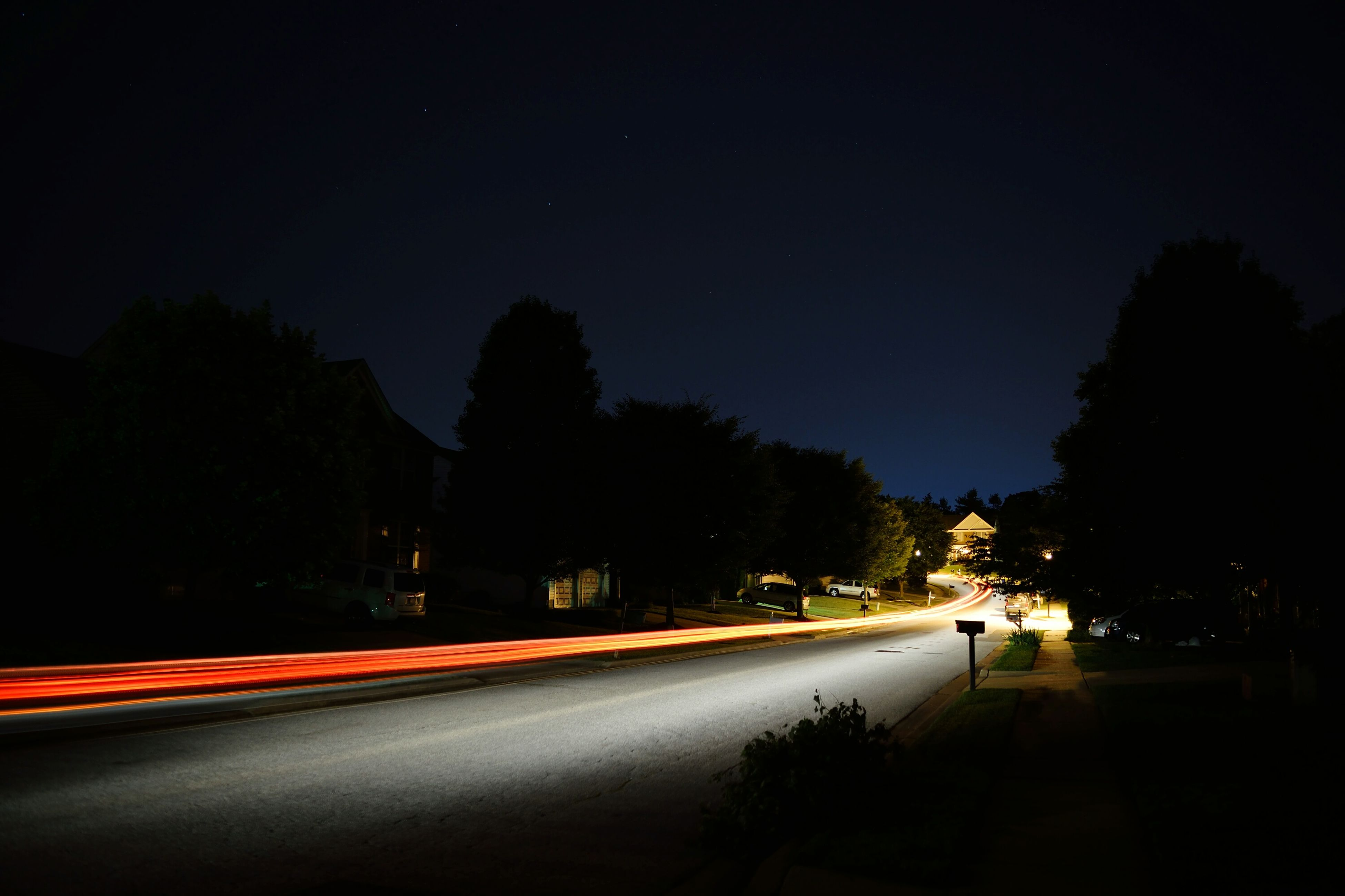 transportation, night, road, illuminated, street, the way forward, light trail, road marking, tree, long exposure, car, copy space, clear sky, motion, speed, sky, land vehicle, blurred motion, on the move, outdoors