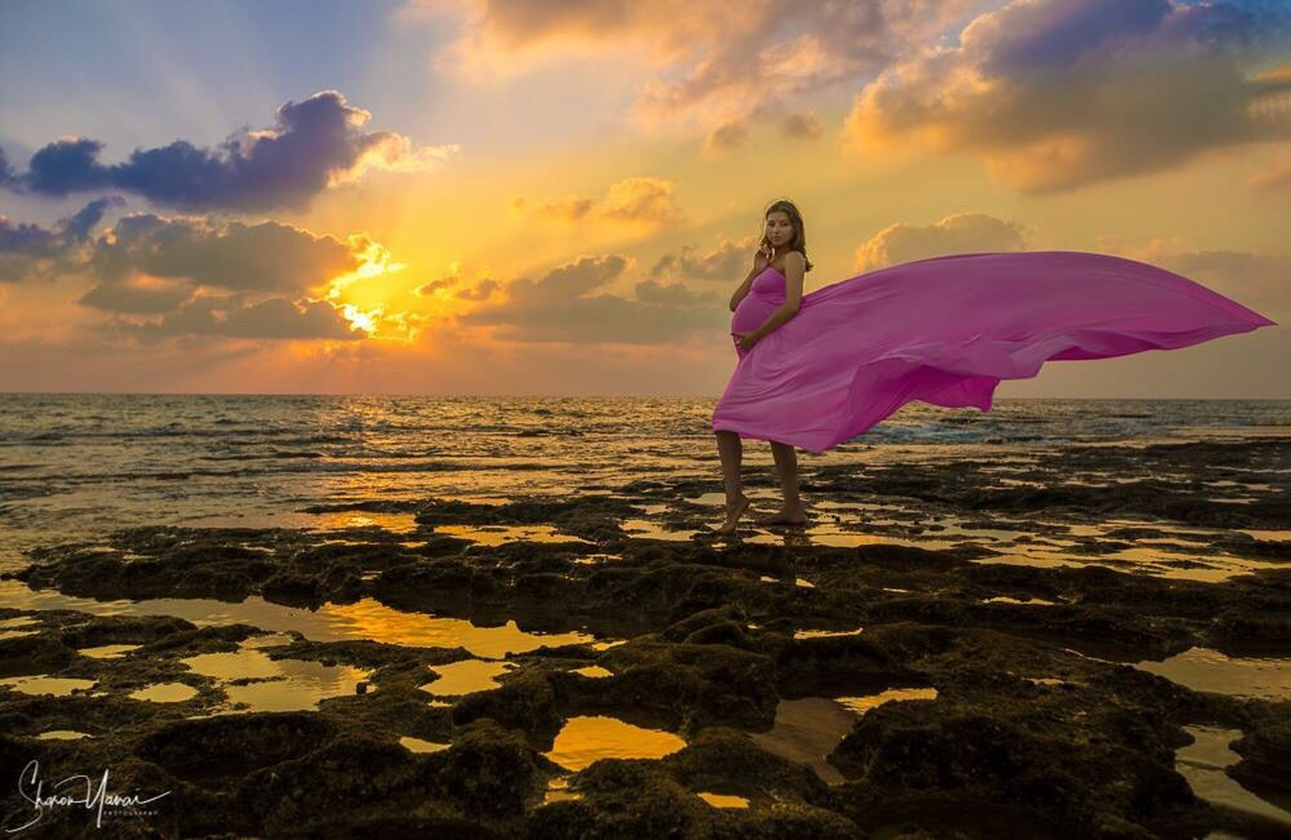 sunset, sea, one person, beach, nature, beauty in nature, cloud - sky, sky, tranquility, full length, scenics, women, tranquil scene, water, sun, horizon over water, outdoors, young adult, beautiful woman, real people, standing, adult, young women, portrait, glamour, only women, one woman only, one young woman only, people, adults only, day