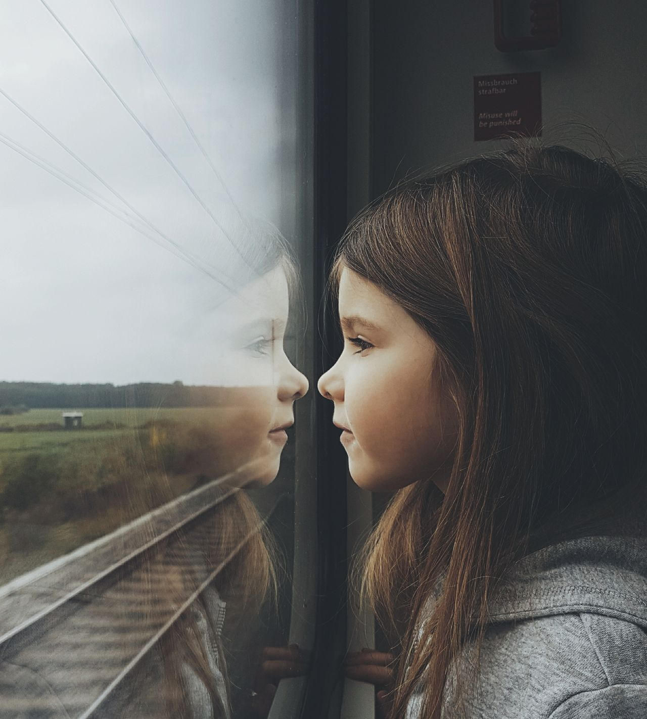 The Portraitist - 2017 EyeEm Awards Looking Through Window Window Railroad Track Train - Vehicle Looking One Person Only Women Fog People Beauty Adult One Woman Only Child Young Adult Females Young Women One Young Woman Only Sky Day Outdoors Eye4photography  EyeEm Best Shots Reflection