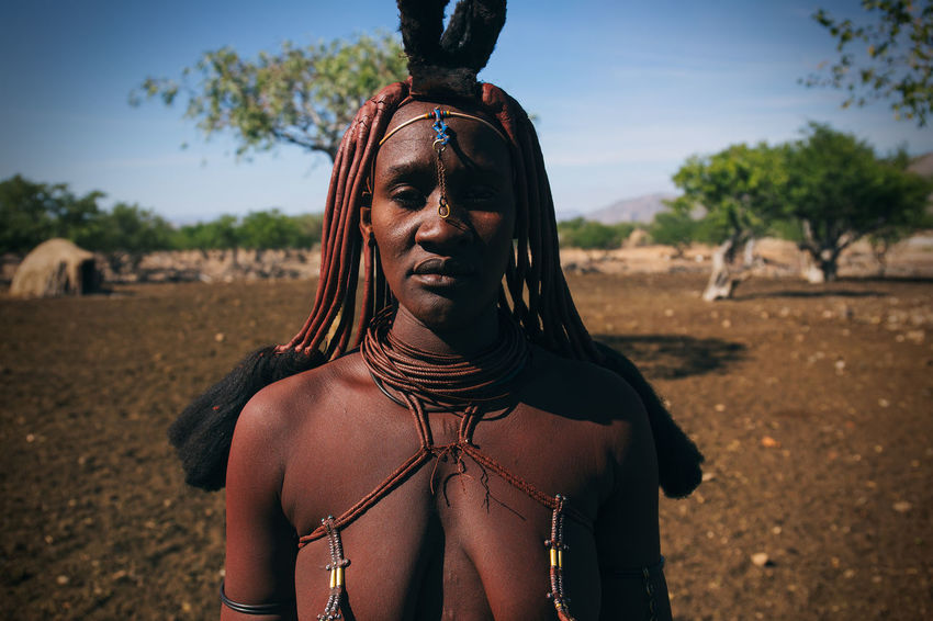 Himba Tribe, Damaraland, Northern Namibia Africa African African Beauty Black Women Around The World Dirt Dreadlocks Ethnic Focus On Foreground Headshot Himba Hut Indigenous  Namibia Ochre Portrait Remote Rural Strength Tribal Tribe Village Woman Woman Portrait Women