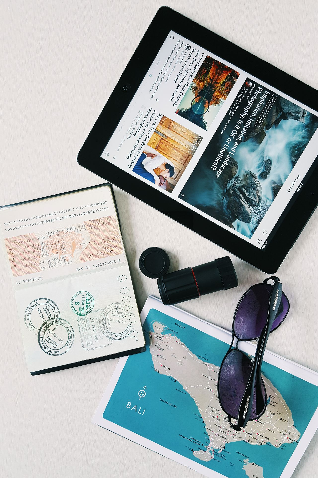 Binoculars Business Finance And Industry Close-up Communication Connection Day Digital Tablet Equipment Indoors  Investment Map Mobile Phone No People Passport Portability Portable Information Device Smart Phone Sun Glasses Technology Wireless Technology