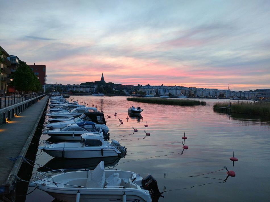 Late summer at boardwalk Sunset Reflection Water Urban Skyline No People Day Architecture Sky Colorful Zen Sweden Dailyphoto Amature Mindful Colors Stockholm EyeEmNewHere Dawn Boardwalk Boat Boats Outdoors Lake Canal Scandinavia EyeEmNewHere