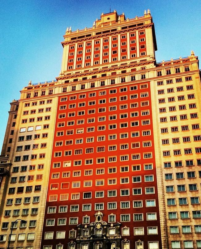 Edificio España Madrid Architecture Building Exterior Built Structure Tall - High Low Angle View Clear Sky City Tower Travel Destinations Famous Place Capital Cities  Tourism City Life Day Outdoors Office Building Sky International Landmark Orange Color Red First Eyeem Photo