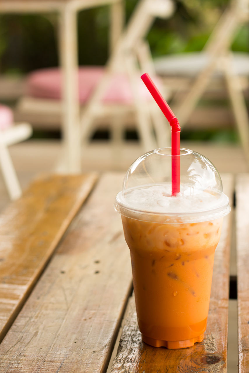 drink, drinking straw, food and drink, table, refreshment, focus on foreground, no people, drinking glass, close-up, freshness, coffee - drink, indoors, day, iced coffee, healthy eating