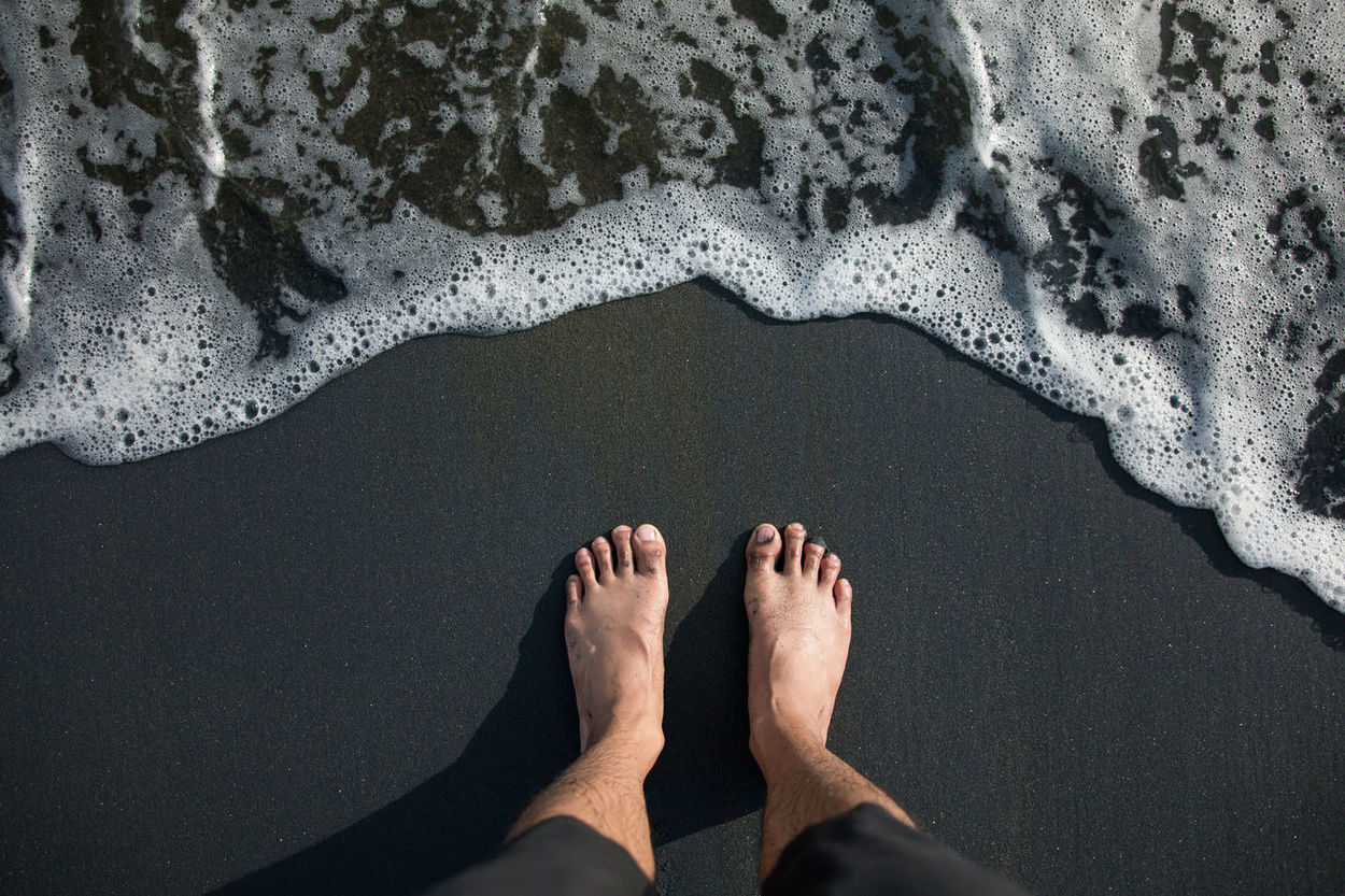 Waiting for the waves Barefoot Beach Beauty In Nature Black Beauty Day Directly Above Feet High Angle View Human Body Part Human Foot Human Leg Low Section Matte Black Ocean One Person Outdoors POV Real People Sand Sea Sea Foam Shadow Standing Water Wave