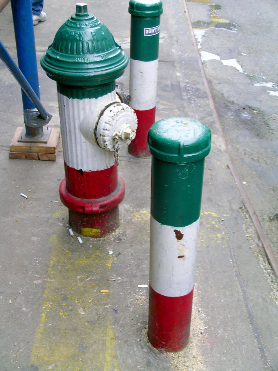 outdoors, fire hydrant, day, street, road, aerosol can, no people, red, traffic cone, multi colored, drum - container