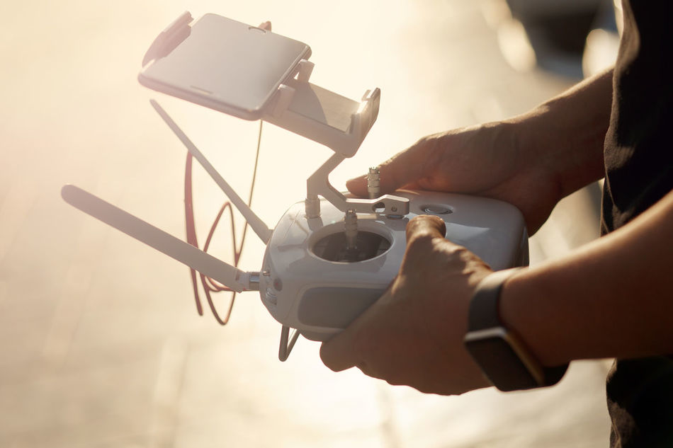 Drone controller Adult Antenna - Aerial Close-up Connection Controller Day Digital Art Drone  Flying Gadget GPS Holding Horizon Over Water Human Body Part Human Hand One Person Outdoors Radio Remote Technology