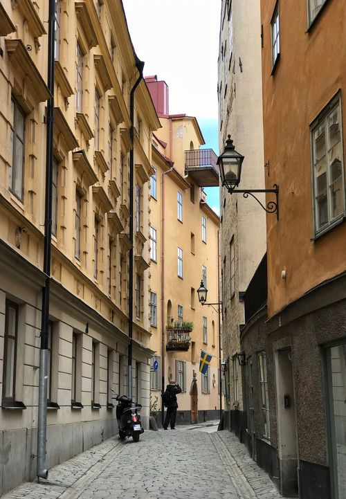 Shooting the Shooter The Street Photographer - 2017 EyeEm Awards Architecture Building Exterior Built Structure Residential Building City Balcony Street Window Low Angle View Day Sky Outdoors Shoot The Shooter EyeEm Best Shots People Taking Photos City Life Old Town Architecture Stockholm, Sweden Street Photography EyeEm EyeEm Gallery Life Apartment