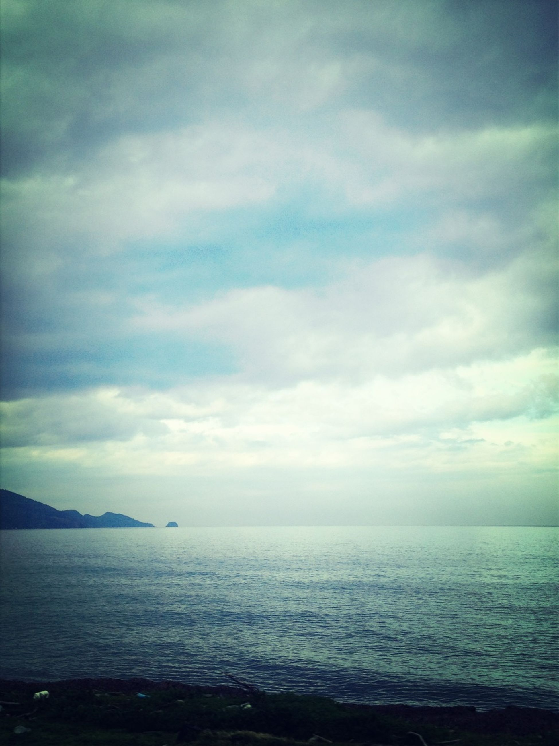 sea, horizon over water, sky, water, scenics, tranquil scene, tranquility, beauty in nature, cloud - sky, cloudy, nature, cloud, idyllic, waterfront, weather, overcast, beach, seascape, outdoors, dusk