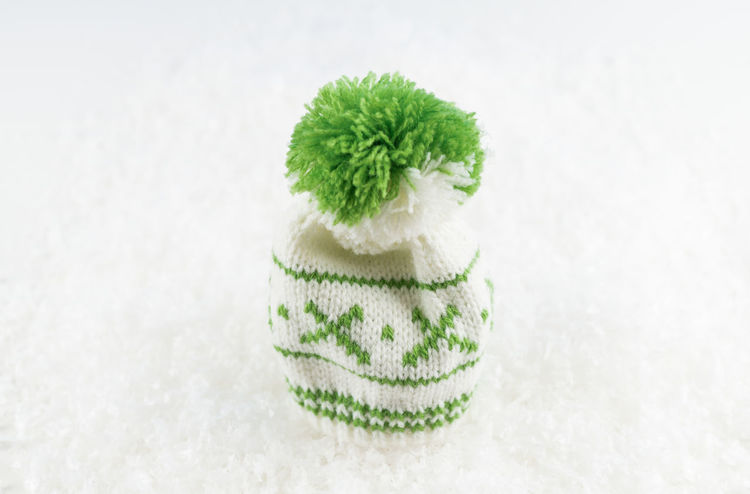Winter Bobble Cap Bobble Hat  Cap Close-up Cold Day Green Color Headwear Indoors  No People Snow Snowflake Studio Shot White Background Wool