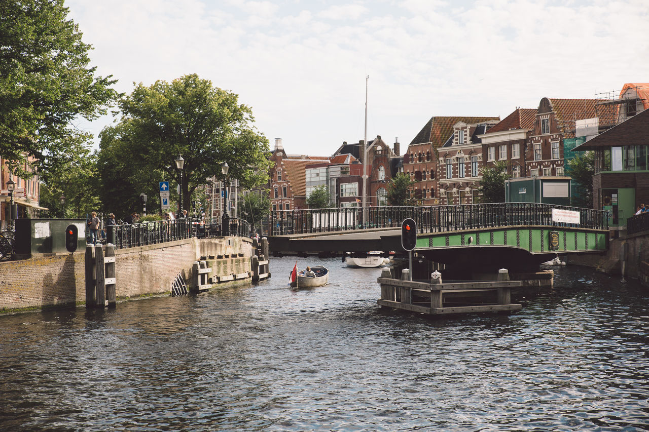 Architecture Haarlem Haarlemse Haarlemse Vaardagen 2017 Architecture Boats Building Exterior Built Structure Canal City Cruise Day Dutch Nature Nautical Vessel One Person Outdoors People Real People Residential Building River Ships Sky Spaarne Transportation Tree Vaardagen Water Waterfront