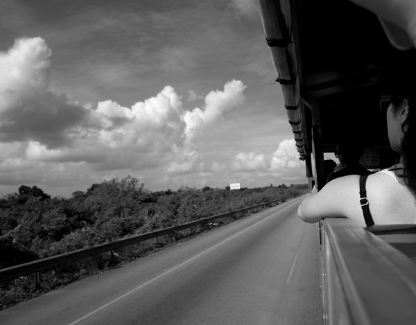 tour bus Vacation Holiday Camera Photography Blackandwhite Monochrone Bnw Dominican Republic Monochrome Women Passenger Bus Contrast Highway Road Forest Sky Road Transportation Cloud - Sky The Way Forward Driving Speed Car Sky Day Outdoors Nature An Eye For Travel