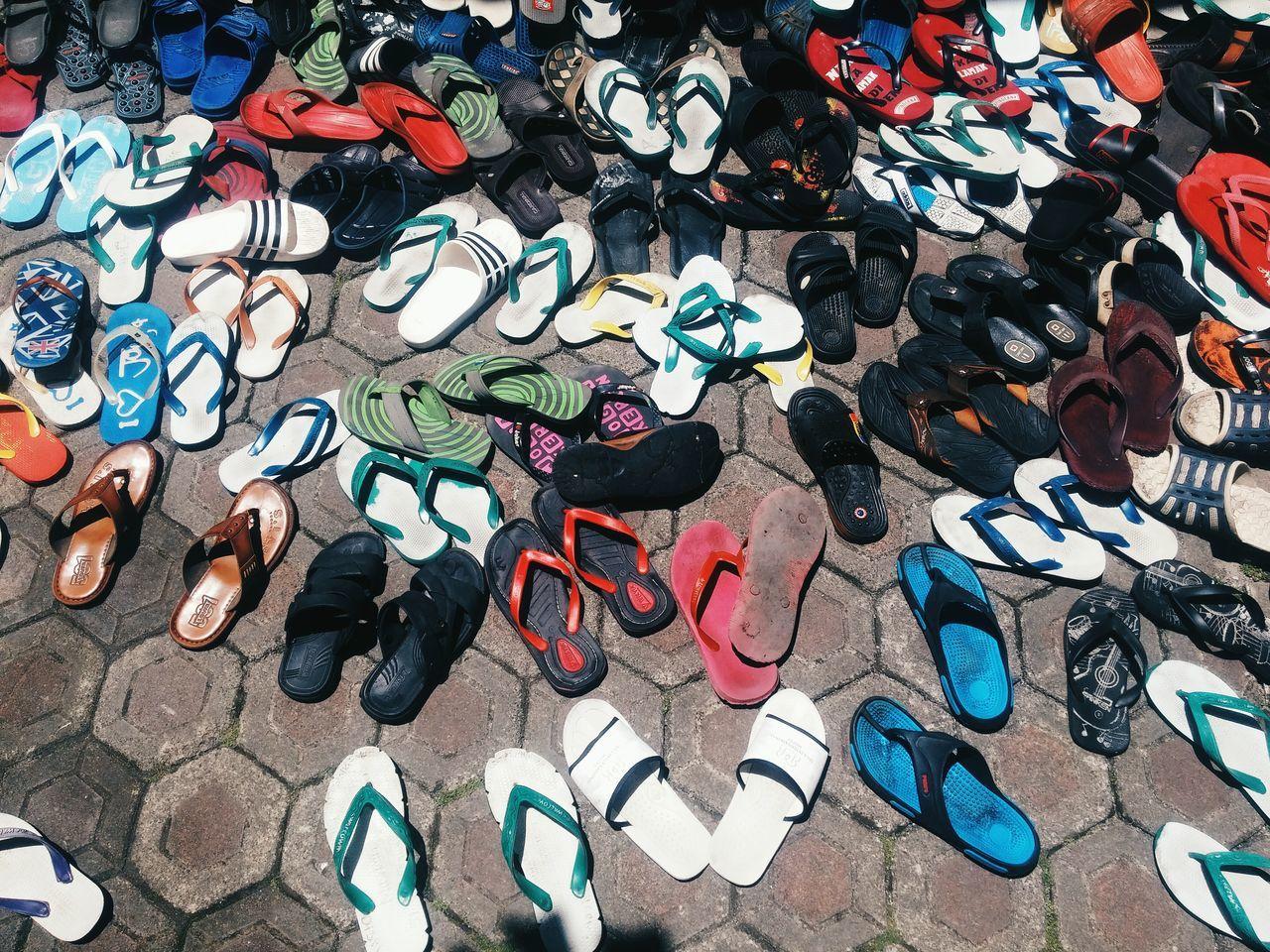 High Angle View Of Footwear On Walkway
