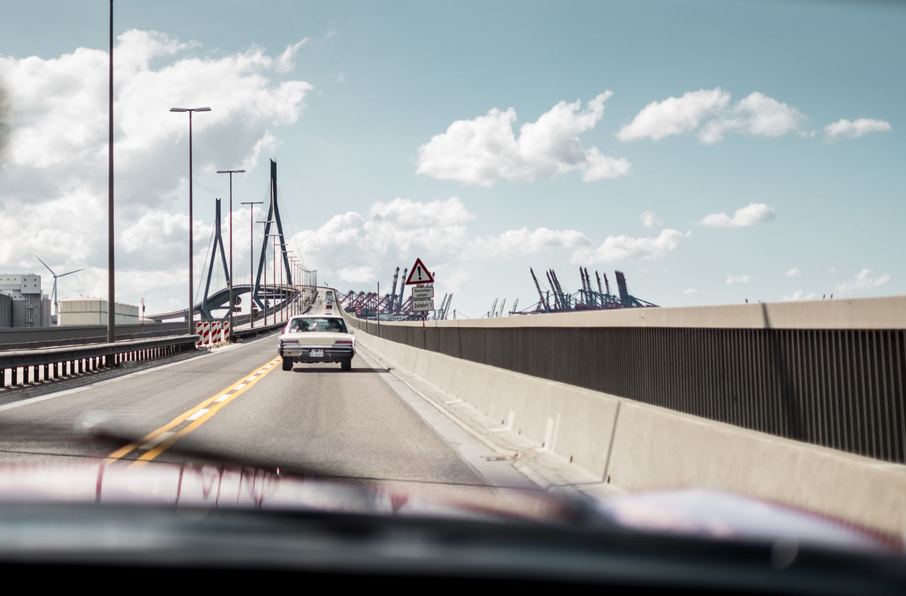 The Chase. (1) Driving over famous Köhlbrand Bridge (Hamburg, Germany) in a Cadillac and a Chrysler. 35mm Blue Sky Bridge - Man Made Structure Built Structure Cadillac Car Carporn Chrysler Classic Car Deutschland Driving Fujifilm Fujinon Germany Hamburg Hamburg City Köhlbrandbrücke No People On The Road Outdoors Roadtrip Sky Traffic Transportation X-T10