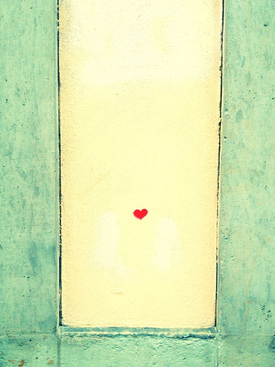 Little red heart on wall