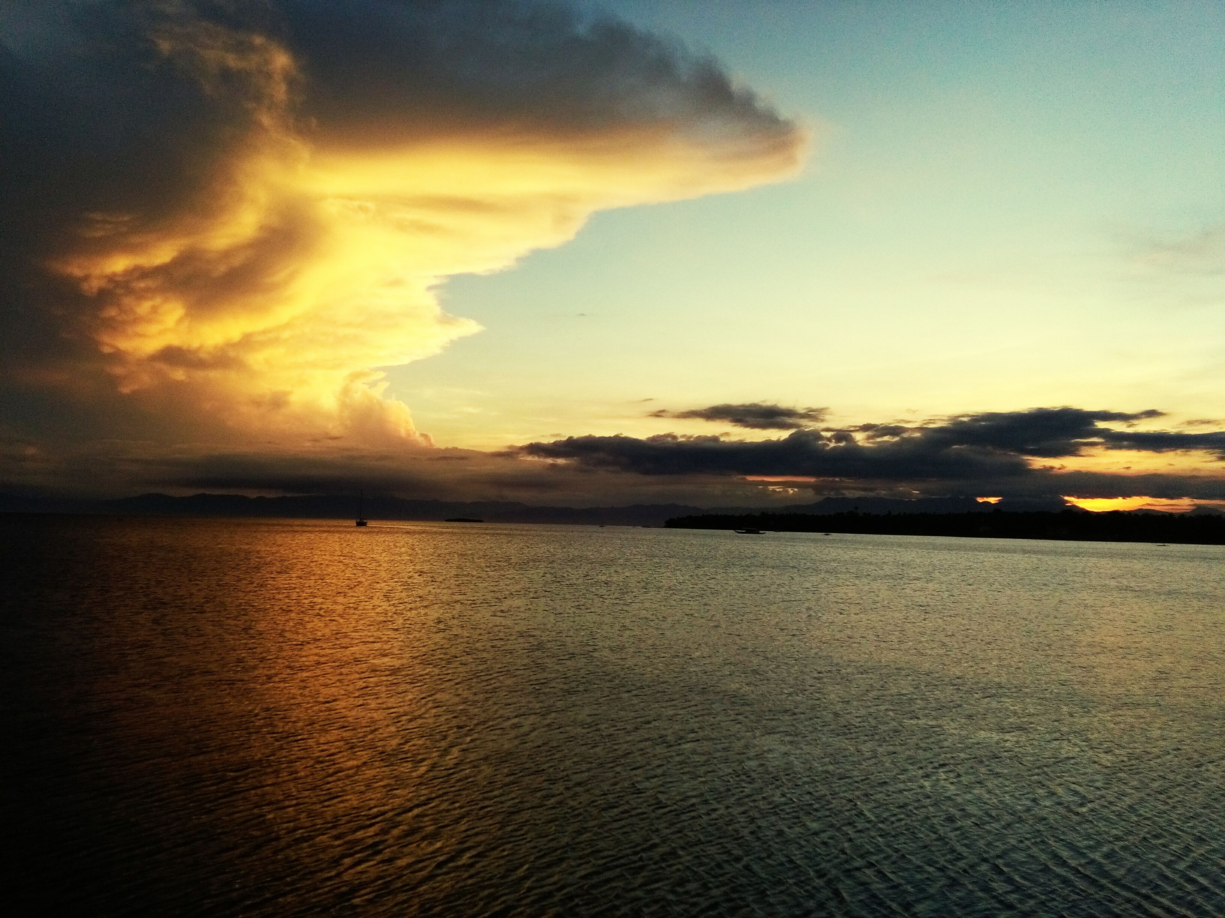 sunset, water, sky, sea, scenics, tranquil scene, beauty in nature, tranquility, cloud - sky, horizon over water, idyllic, nature, waterfront, cloud, cloudy, reflection, orange color, dramatic sky, dusk, outdoors