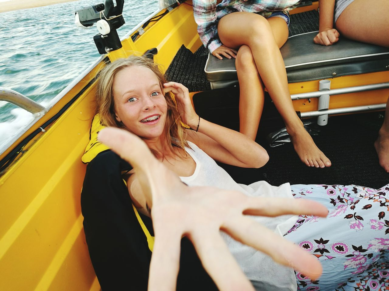 High Angle Portrait Of Smiling Young Woman Traveling In Boat