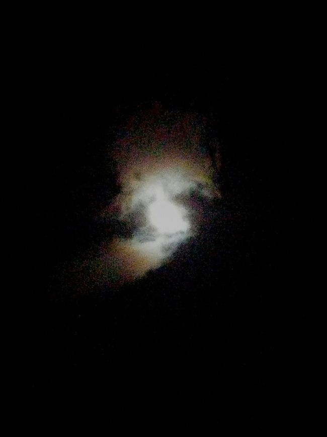 Clouds With Orbs Passing By The Moon