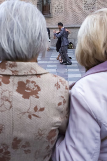 Two elderly women looking at a young couple dancing the tango in Madrid. City City Life City Street Fun Travel View Adult Editorial  Holding Outdoors People Real People Rear View Senior Adult Senior Couple Senior Women Street Tango Tango Dancers Togetherness Travel Destinations Women