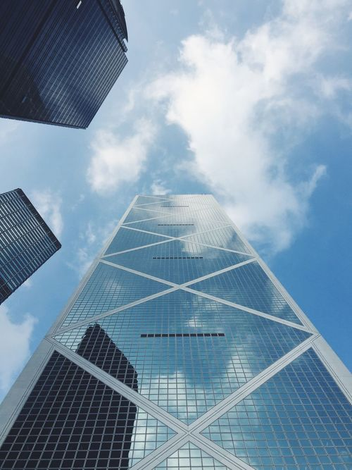 Steel, glass and clouds. HongKong Hong Kong Skyscrapers Skyscraper Architecture Architecture_collection Lookingup Building Highrise Bank Of China Bank Of China Tower Cityscapes Urban Streetphotography Street Photography