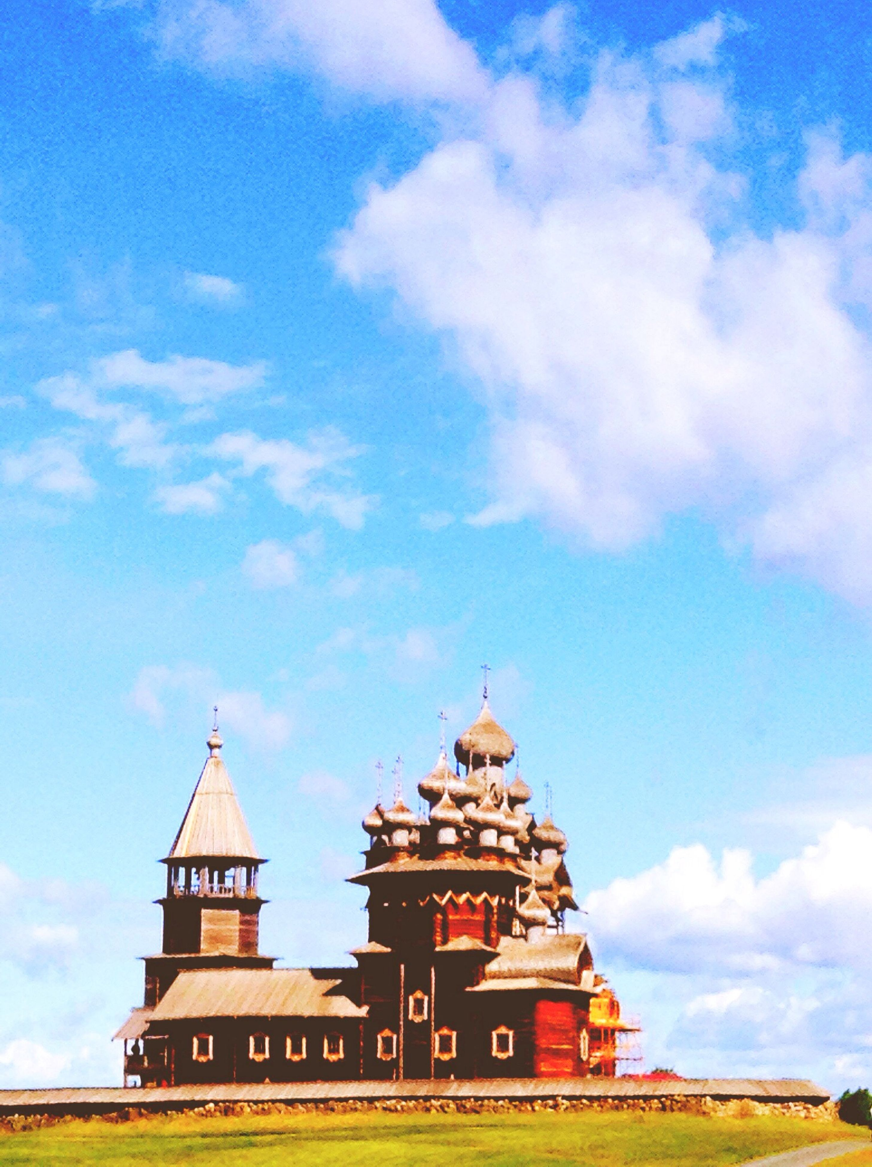 building exterior, architecture, built structure, place of worship, religion, sky, spirituality, church, cloud - sky, low angle view, cloud, blue, cathedral, history, outdoors, cloudy, day, temple - building