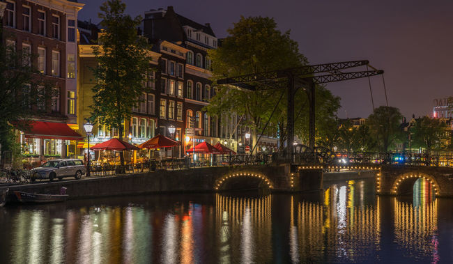 Amsterdam, kloveniersburgwal Amsterdam Architecture Bridge Bridge - Man Made Structure Canal Houses Capital Cities  City Life Dutch Evening Historical Building Nederland Netherlands Reflection Travel Destinations Water