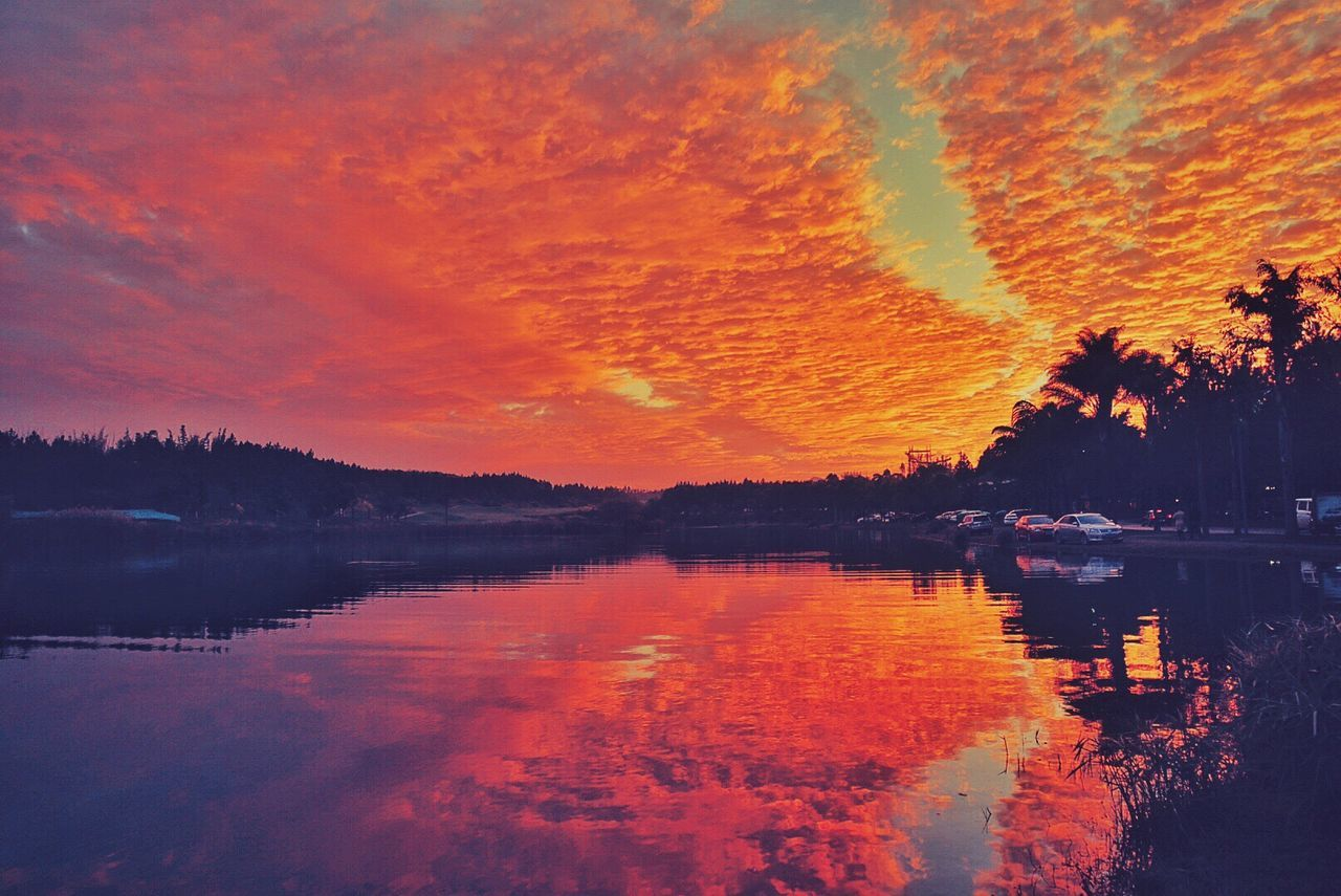 reflection, water, sunset, lake, beauty in nature, nature, tree, scenics, tranquil scene, sky, tranquility, outdoors, waterfront, no people, day