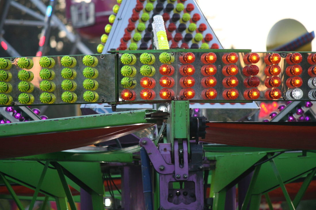 Abundance Arrangement Capital Lakefair 2016 Carnival Carnival Lights Carnival Lights Multi Colored Close-up Colorful Day Fair Fairground Attraction Fairgrounds Focus On Foreground Green Color Illuminated Multi Colored No People Olympia Selective Focus Sky