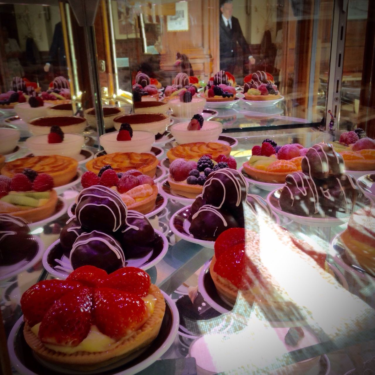 sweet food, dessert, food and drink, temptation, indulgence, food, freshness, indoors, unhealthy eating, retail, store, for sale, bakery, choice, variation, cake, multi colored, ready-to-eat, no people, close-up, ice cream, day