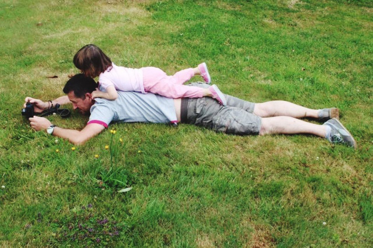 grass, lying down, full length, togetherness, lying on back, casual clothing, two people, day, pets, childhood, relaxation, outdoors, dog, sitting, adult, bonding, domestic animals, happiness, girls, people, animal themes, young adult