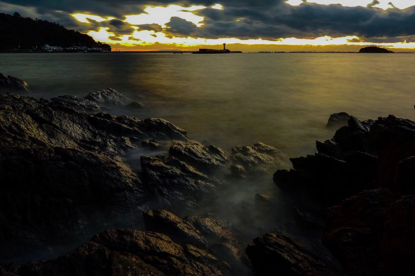 Nature Water Sunset Sky Beauty In Nature Rock - Object Tranquility Sea Scenics Cloud - Sky Tranquil Scene Exceptional Photographs EyeEm Gallery Photography No People Outdoors Horizon Over Water Day