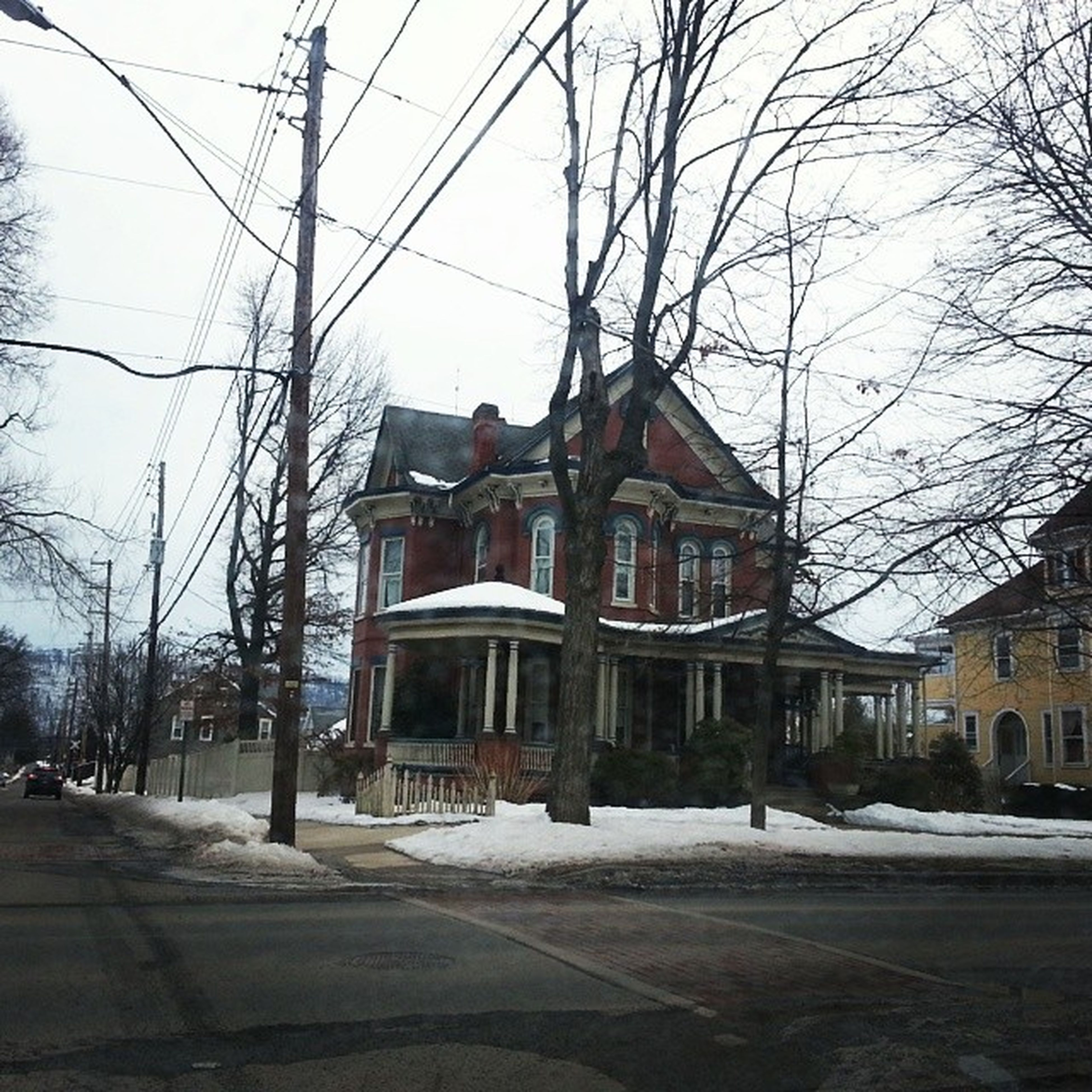 Red house Victorian Mansion Ironstreet Bloomsburg Pennsylvania street overcast